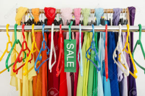 29225759-Empty-rack-of-clothes-and-hangers-after-a-big-sale-Sale-sign--Stock-Photo